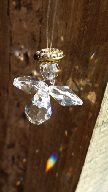 I have three small crystal angels that make rainbows in the sunshine :)